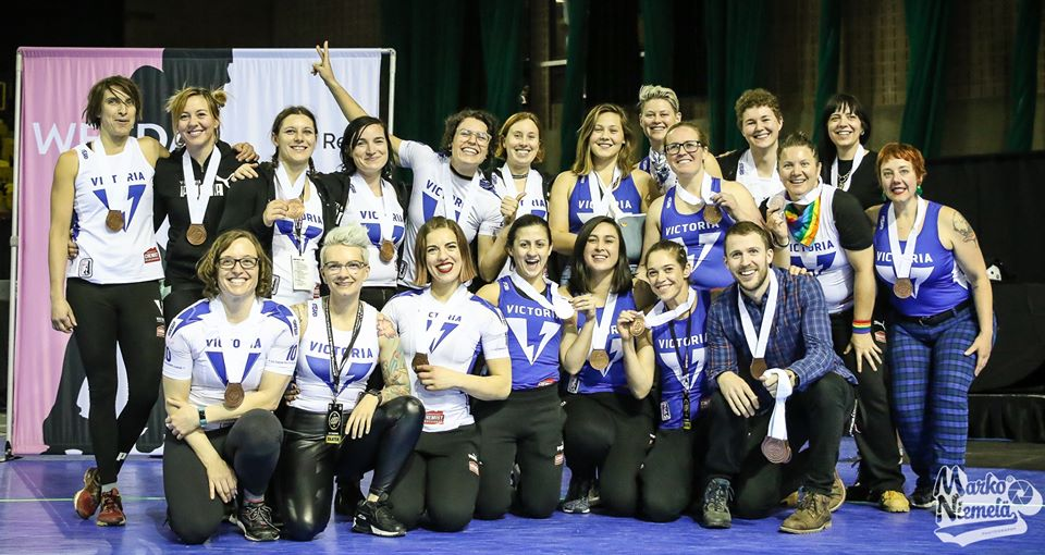 2019 Victorian Roller Derby All Stars pose for a group photo with their newly accepted Bronze medals.
